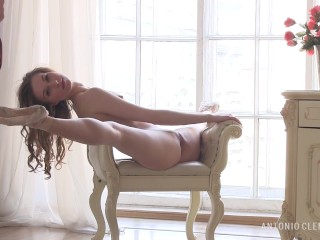 Nude beautiful ballerina openly posing near the window. Preview.